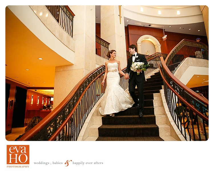 Piper and Matt walk down the grand staircase at InterContinental Chicago