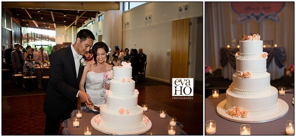 Newlyweds cutting their beautifully decorated wedding cake