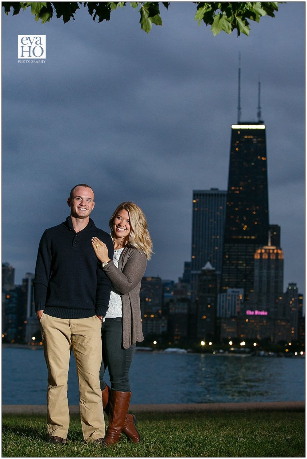 North Ave Beach with Chicago skyline as a backdrop for their night time engagement sesion