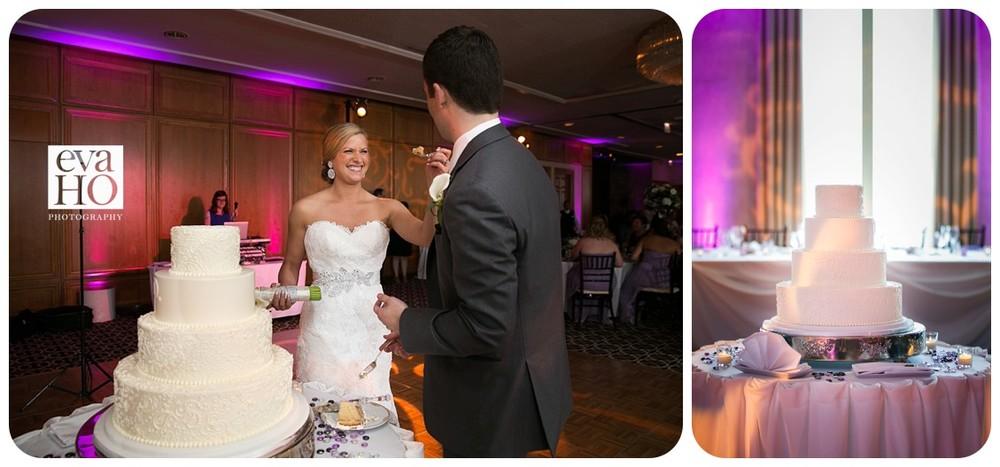 Newly weds cutting their wedding cake