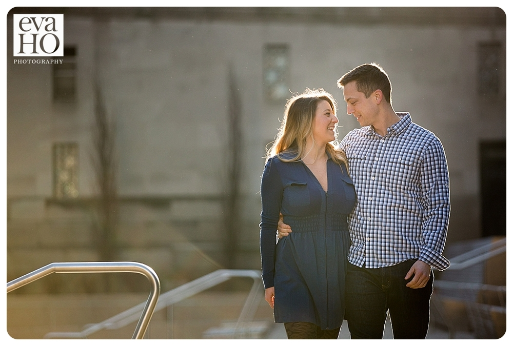 A newly engaged couple strolls down the River Walk in the Cathedral district of Chicago