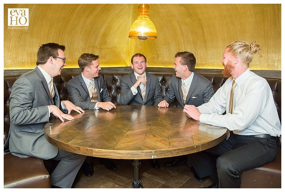 Groom and his groomsmen having relaxing moment before the ceremony.