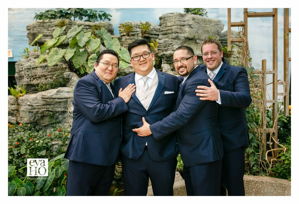 Inside the Butterfly Haven at Peggy Notebaert Nature Museum with the groomsmen