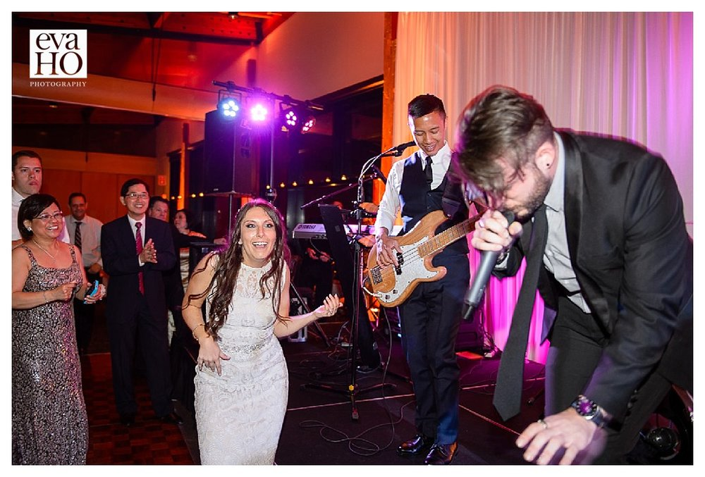 The bride jamming out to her new husband's band!