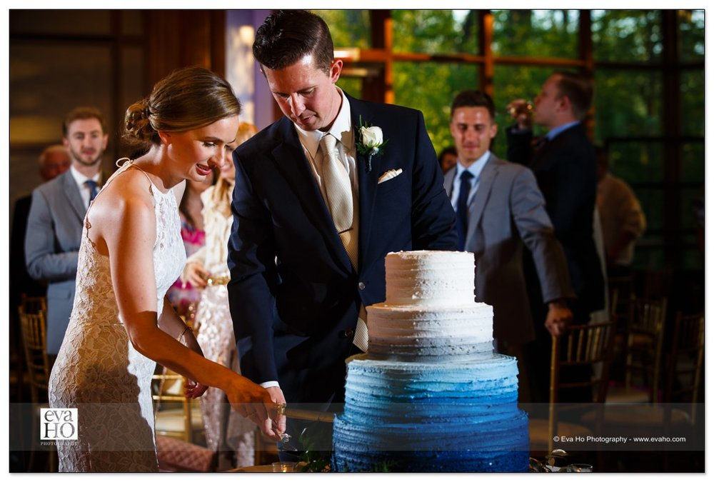 Cutting wedding cake at the Hyatt Lodge at McDonald's campus