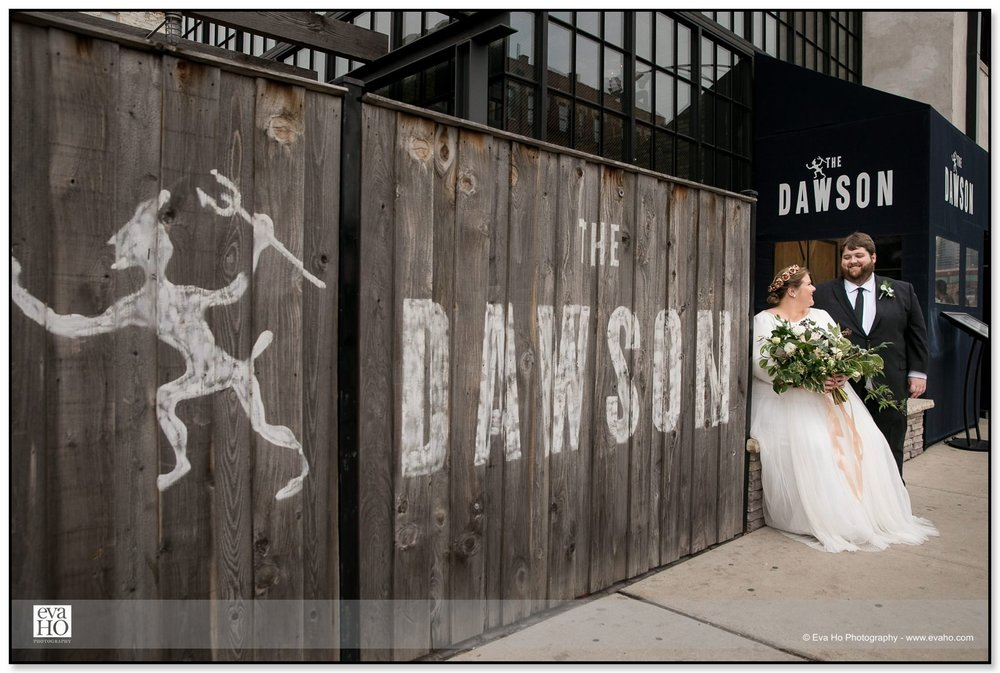 Bride & Groom posing in front of The Dawson in Chicago