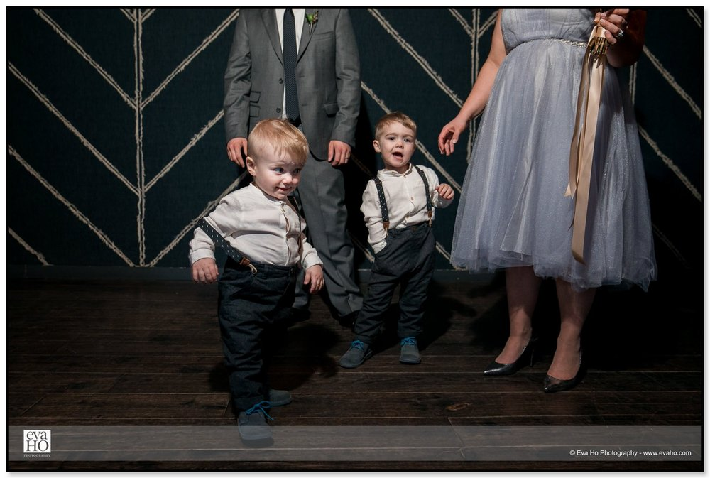 Ring bearers goofing around with parents at a Chicago wedding
