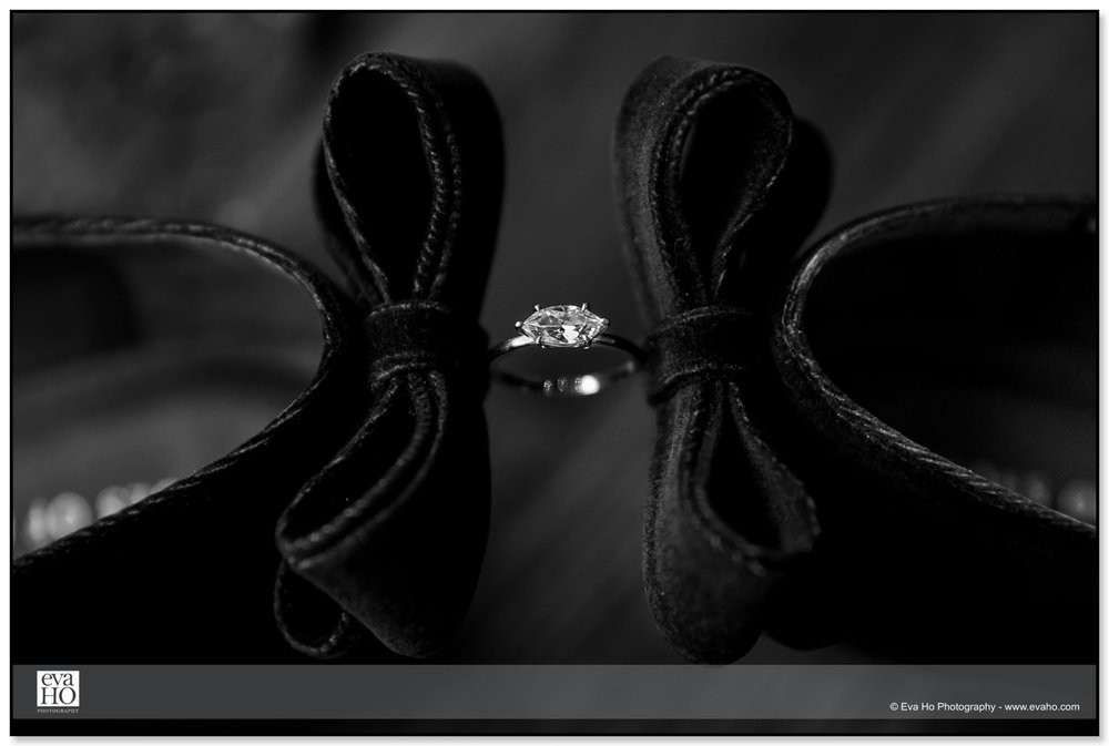 Black & white, modern portrait of an engagement ring and bride's shoes