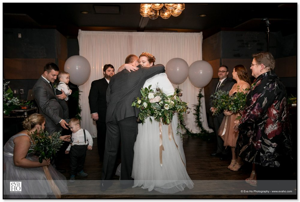Bride hugging her father at the head of the aisle during a Chicago wedding at The Dawson