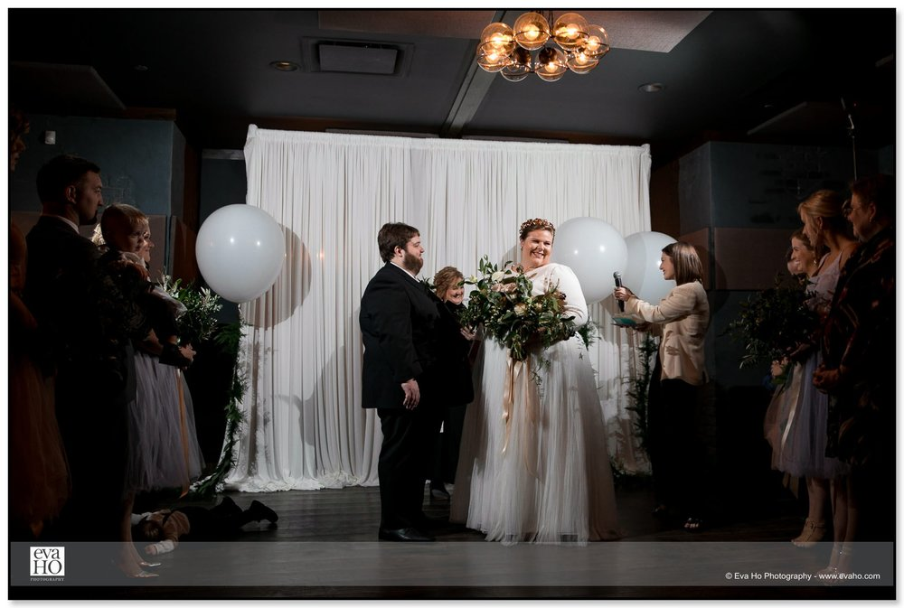 Bride and groom laughing during ceremony at The Dawson in Chicago