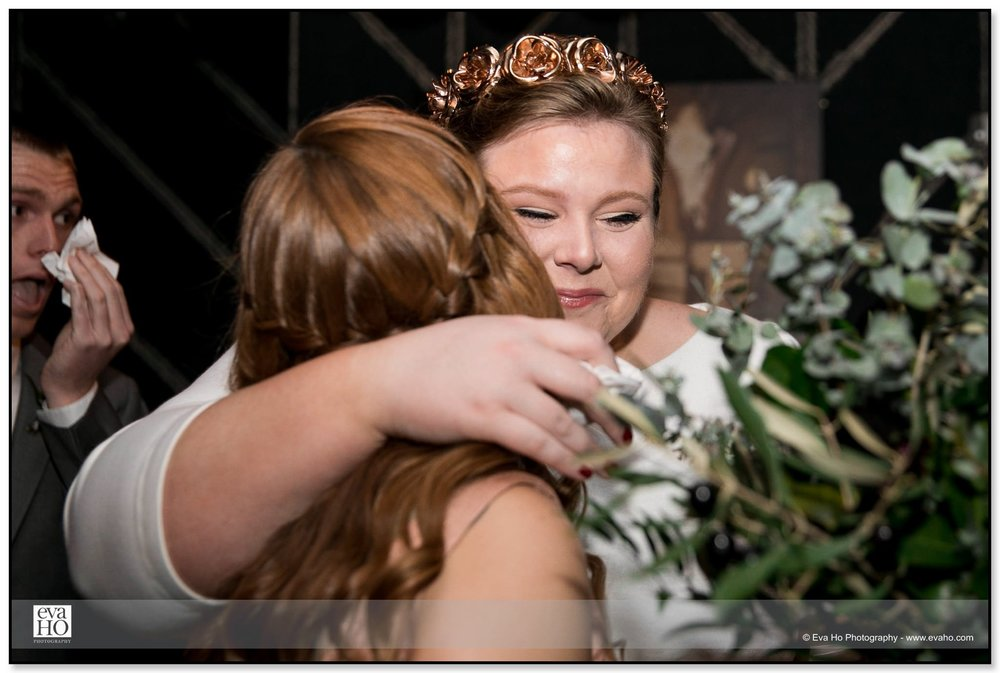 Bride hugging friend after wedding ceremony at The Dawson in Chicago