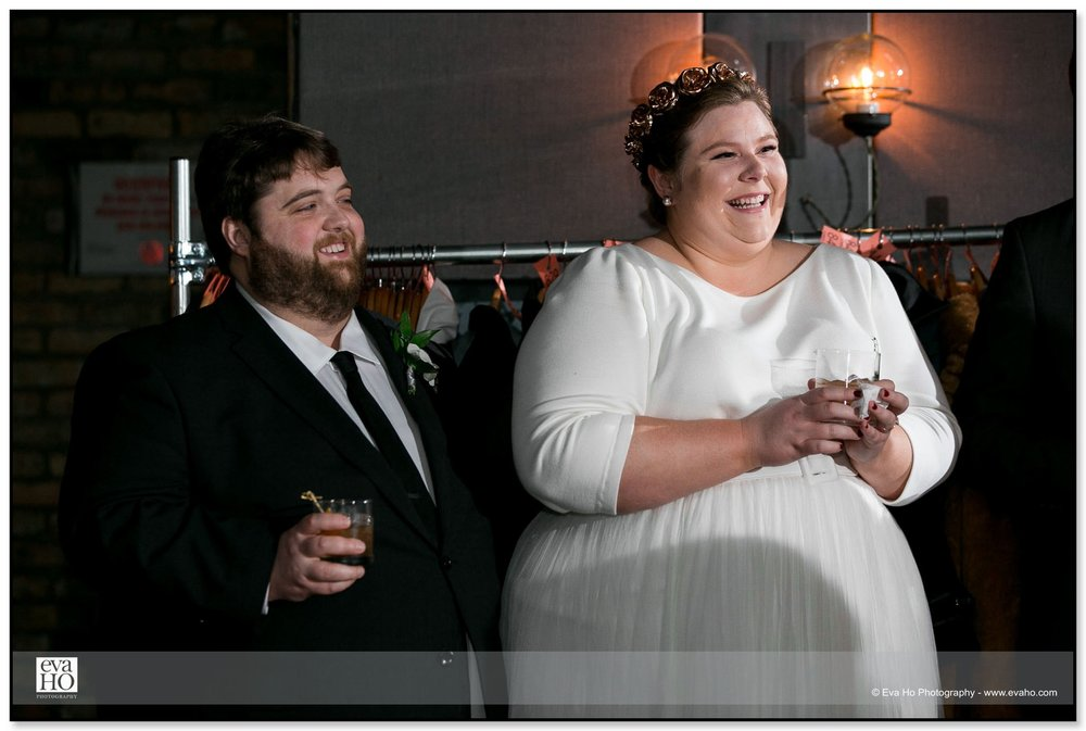 Bride & groom laughing at the toast during Chicago wedding reception