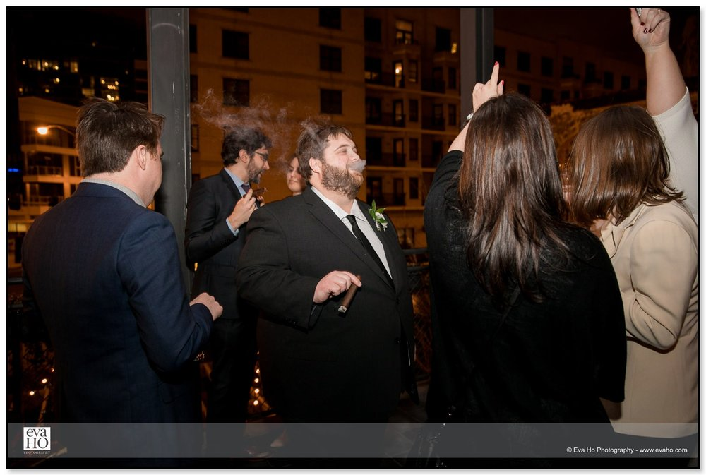 Groom smoking celeberatory cigars with groomsmen at The Dawson in Chicago's River North