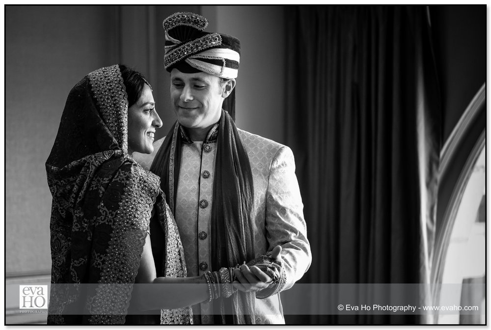 Intimate moment between the bride and the groom before the traditional Indian ceremony.