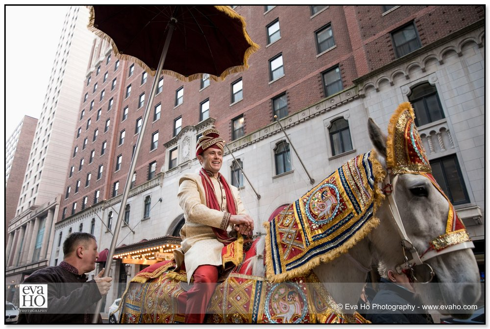 Groom riding the horse during the traditional baraat.