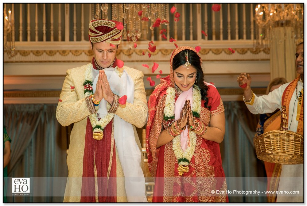 Bride and groom showered with flower petals during this Indian ceremony in Chicago.