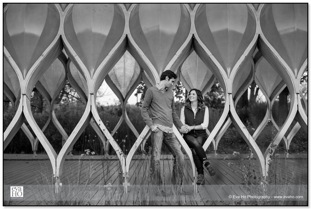 Black & white portrait of an engaged couple in Chicago's famous honeycomb pivilion