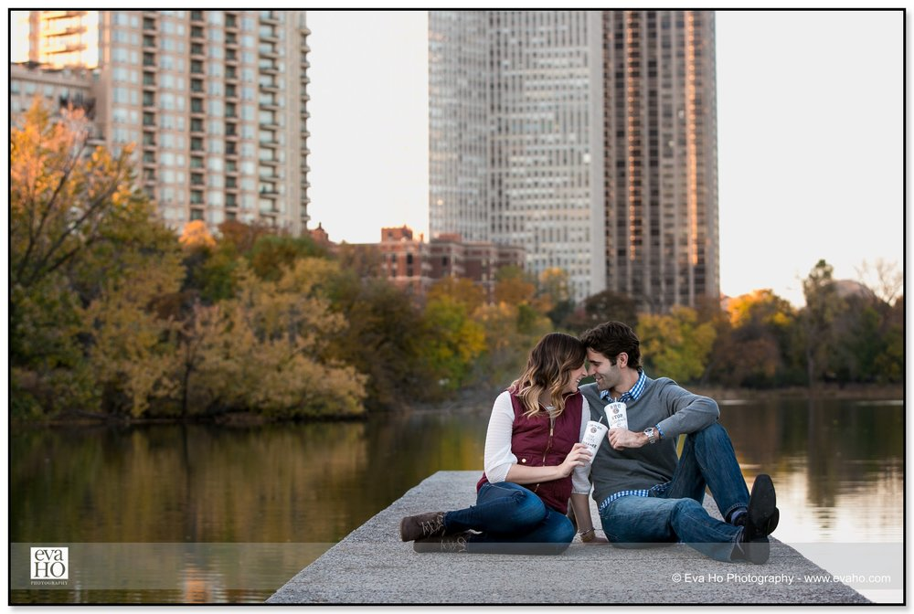 Newly engaged couple drinking hot beverages by the water in Chicago