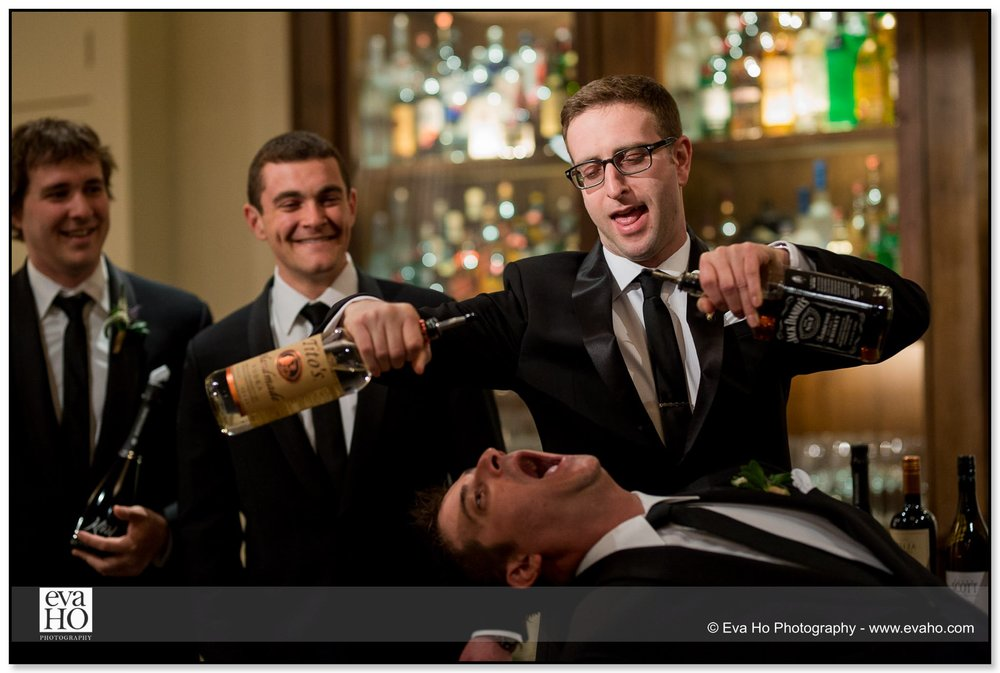 Groomsmen joke around during bridal party portraits at a Chicago wedding in River North