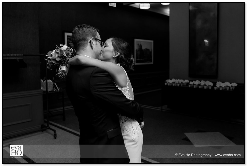 Bride and Groom kiss after leaving their wedding ceremony in Chicago
