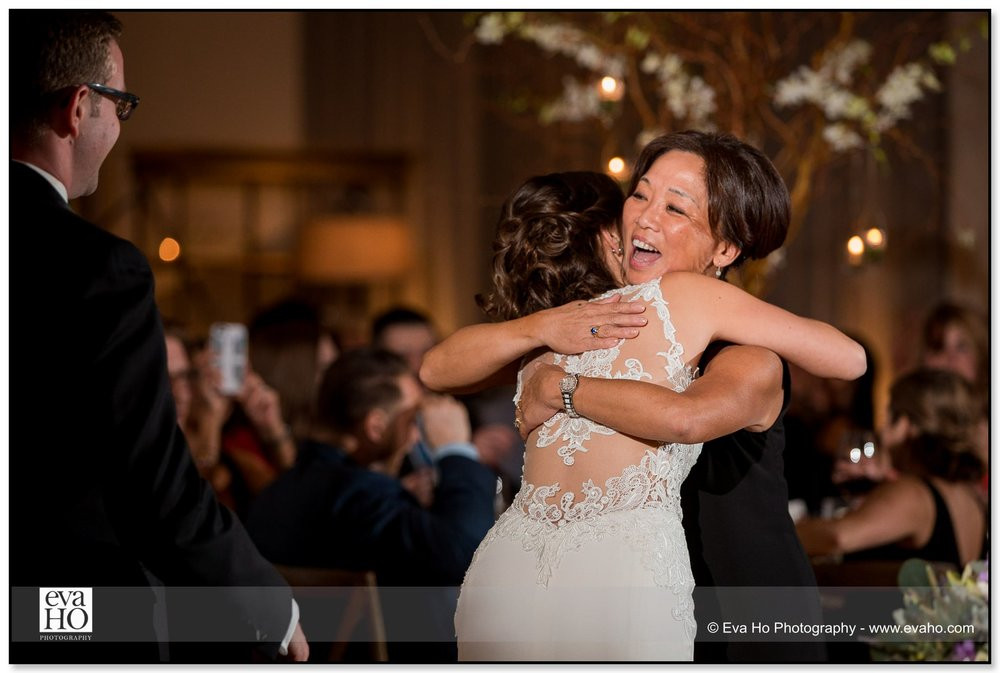 Bride hugs her mother during her wedding reception in Chicago