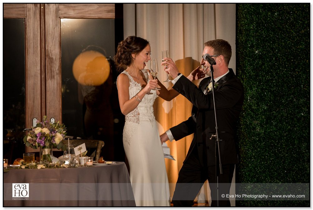 Bride and groom laugh during their toasts at their Hotel Palomar wedding