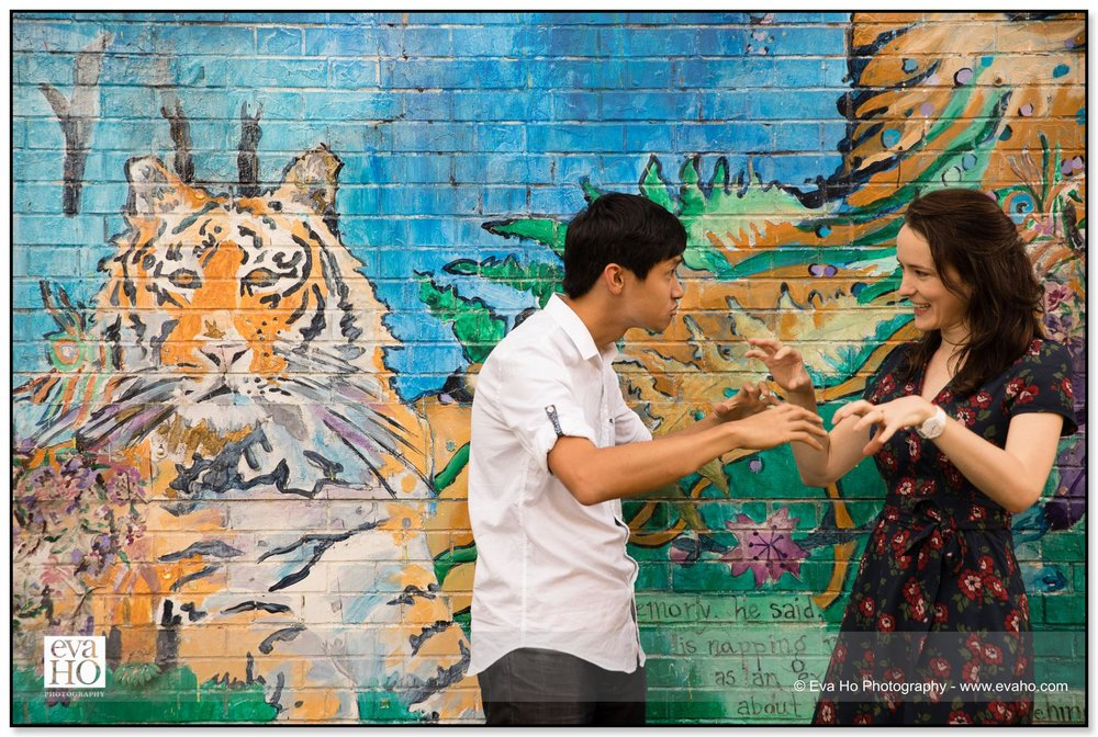 Couple acting silly in front of a tiger mural in Logan Square, Chicago