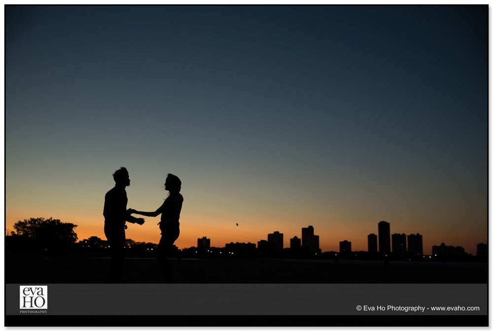 Dancing portrait with the Chicago skyline in the background at sunset