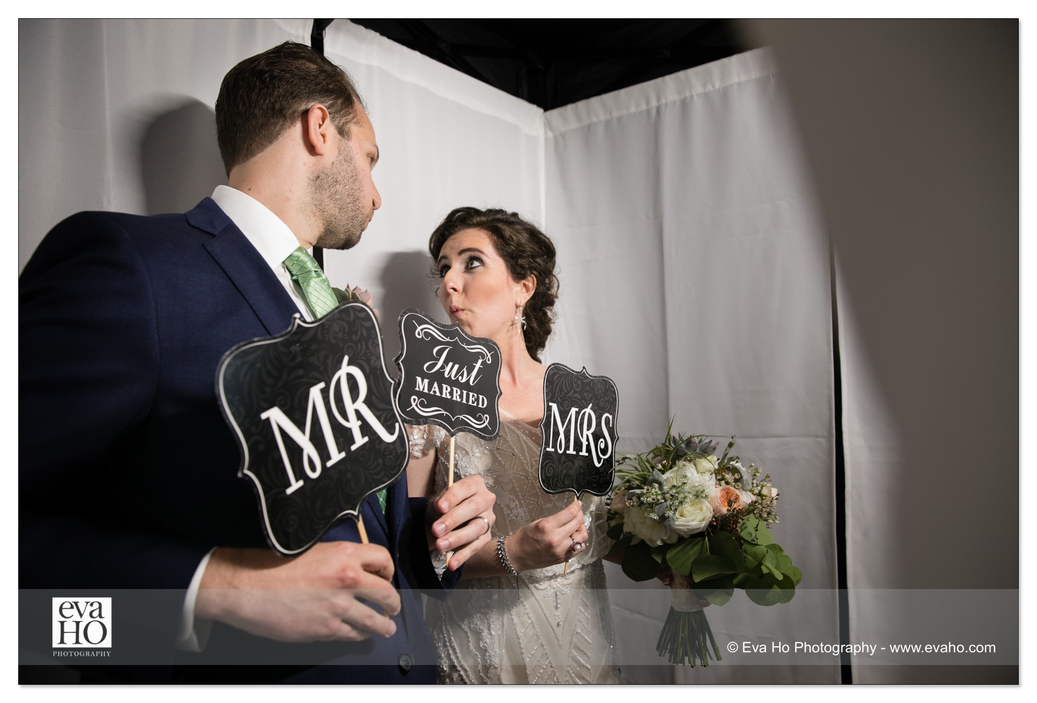 Bride and Groom in a photobooth
